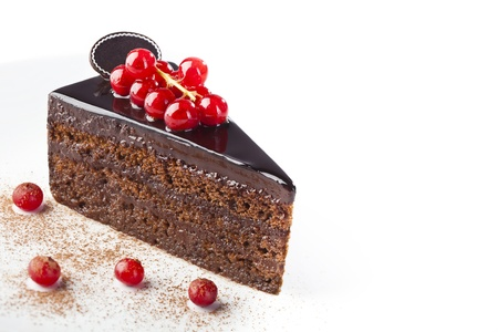 Piece of chocolate cake with red berries on white background Stock Photo - 18151057