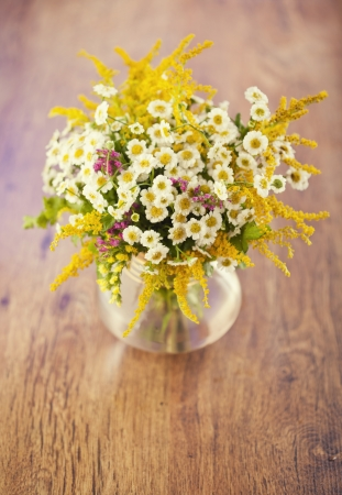 Beautiful bouquet of wild flowers on wooden table Stock Photo - 18151068