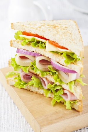 Club sandwich with ham and vegetables photo