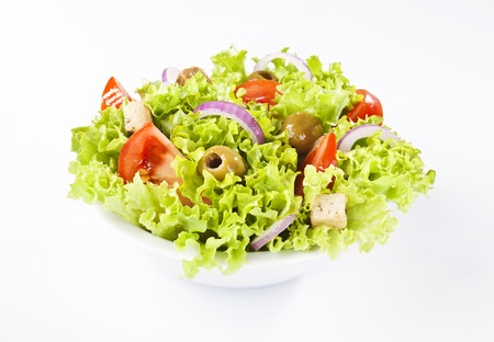 Healthy greek salad on white background Stock Photo - 18372120