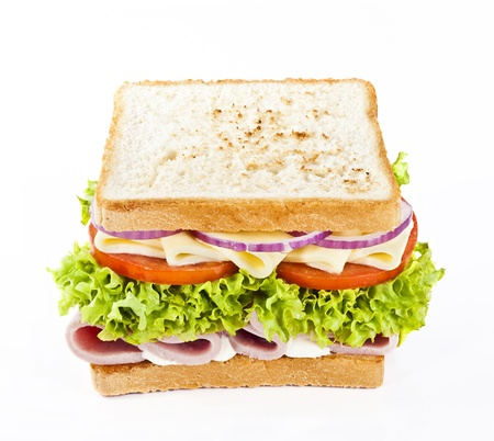 Sandwich with ham, cheese, tomatoes, onions and lettuce  Stock Photo - 18372122
