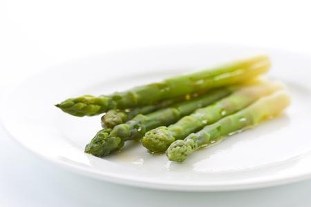 Prepared green asparagus on a plate