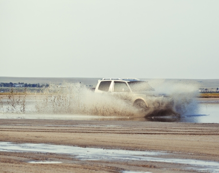 blast off: 4x4 offroad car driving in mud Stock Photo