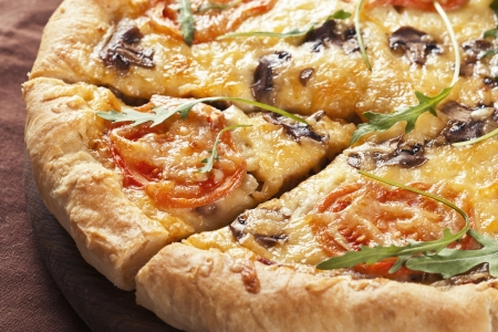 Tasty italian pizza with tomatoes and rucola