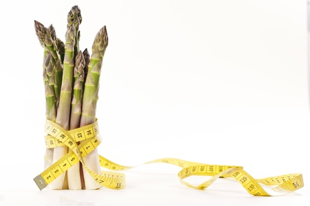 Asparagus and measuring type on a white background photo