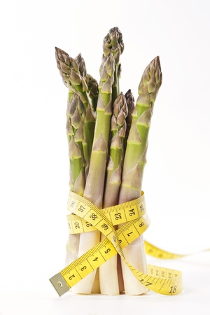 Asparagus and measuring type on a white background Stock Photo - 19009037