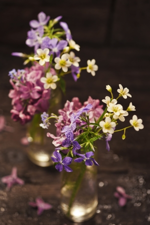 Bouquet of spring flowers on wooden background Stock Photo