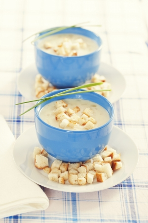 Vegetable cream soup in blue bowls