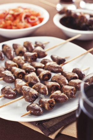 Grilled chicken hearts on skewers with soy sauce and salad. Stock Photo - 19009072