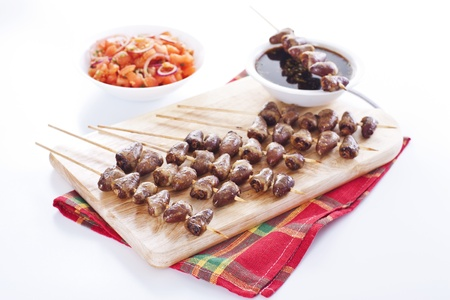Grilled chicken hearts on skewers with soy sauce and salad. Stock Photo - 19009104
