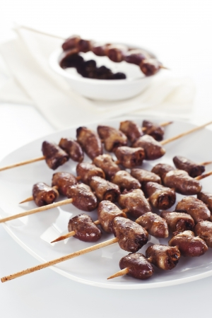 Grilled chicken hearts on skewers with soy sauce and salad. Stock Photo - 19008992