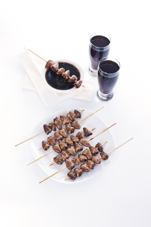 Grilled chicken hearts on skewers with soy sauce and salad. Stock Photo - 19008952