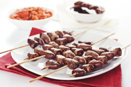 Grilled chicken hearts on skewers with soy sauce and salad. Stock Photo - 19009035