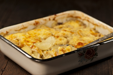 Potato gratin with cheese on rustic background Stock Photo - 19008997