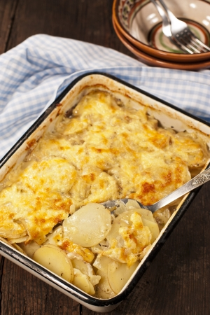 Potato gratin with cheese on rustic background Stock Photo - 19009153