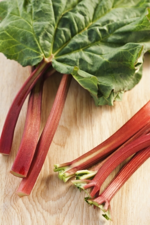 Fresh rhubarb on wooden background