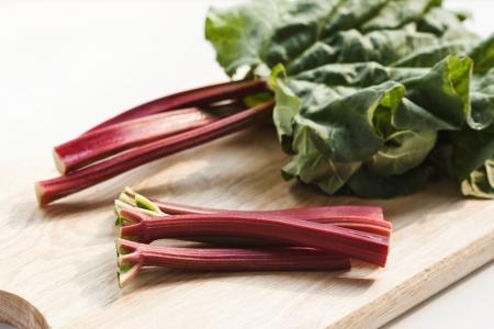 Fresh rhubarb on wooden background Stock Photo - 19009066