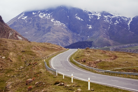 caucasus: Curved high mountain asphalt road. Georgian military highway.