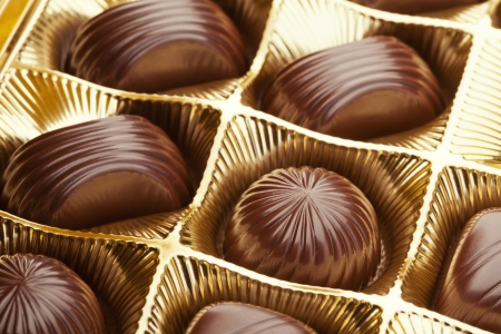 Delicious chocolate pralines in the golden box Stock Photo - 20461840