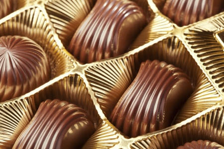 Delicious chocolate pralines in the golden box Stock Photo - 20461841