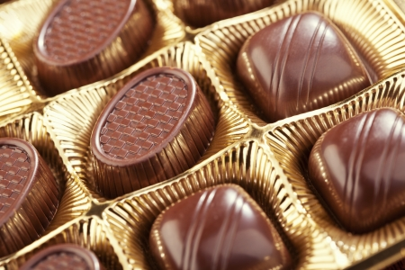 Delicious chocolate pralines in the golden box photo