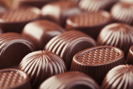 Assorted delicious chocolate pralines background photo