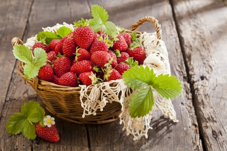 Strawberries in basket on rustic wooden background Stock Photo - 20461846