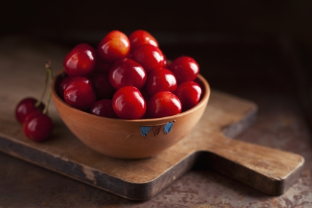 Fresh ripe cherries in a bowl on dark background Stock Photo - 21085796