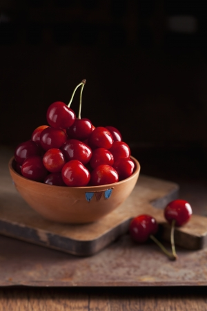 Fresh ripe cherries in a bowl on dark background Stock Photo - 21085797