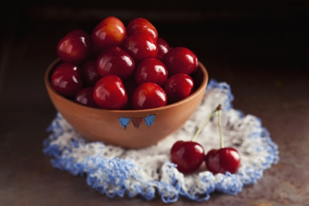 Fresh ripe cherries in a bowl on dark background Stock Photo - 21085798