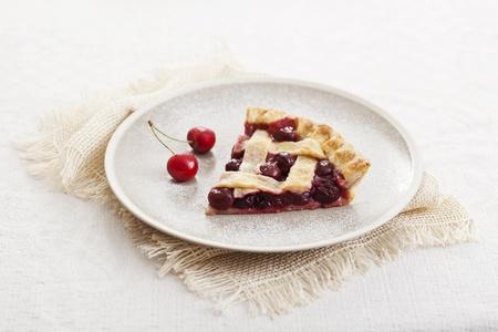Piece of cherry pie with lattice crust Stock Photo - 21085880