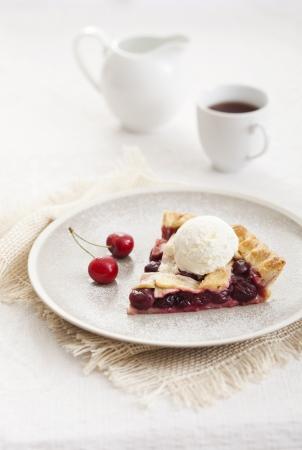 Piece of cherry pie with ice cream Stock Photo - 21085882