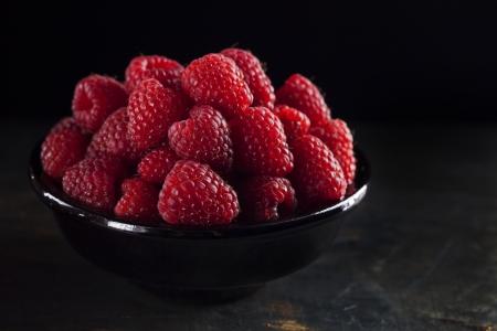 Bowl of fresh raspberry on dark background Stock Photo - 21702818