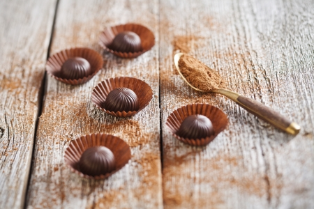 Chocolate candies on wooden background Stock Photo - 21702822