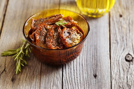 Sun dried tomatoes with olive oil and rosemary Stock Photo - 21702823