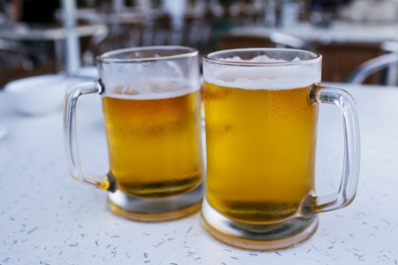 Two mugs of beer in pub Stock Photo - 21702846