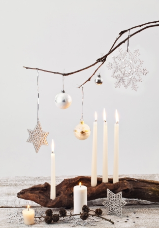 Christmas candles and handmade decorations on white  photo