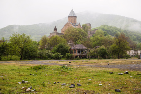 Medieval Ananuri fortress on the Georgian Military Highway in Georgia photo