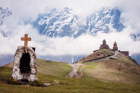 monastery nature: Tsminda Sameba or Holy Trinity Church near the Kazbegi and Gergeti village, Georgia