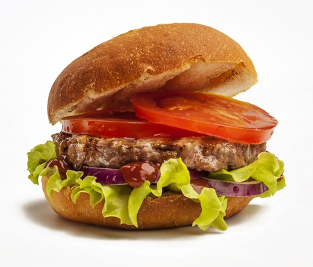 Juicy burger with onion, tomatoes and lettuce isolated on white background