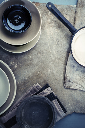 Vintage tableware, cutlery on grey stone backround photo