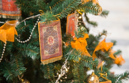 Unusual christmas decoration with carpets in asian style photo