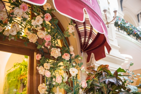 Restaurant entrance canopy in Paris with roses Stock Photo