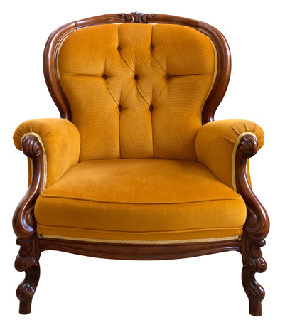 Antique orange armchair isolated on white background photo