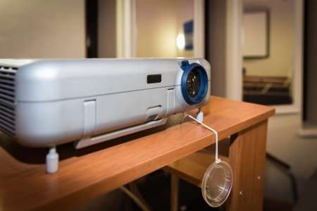 Computer Projector In Conference Hall standing on a table photo