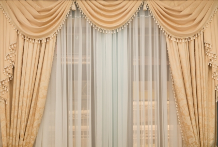 classic beige curtain hanging on a window Banco de Imagens