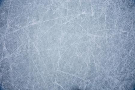 hockey sobre hielo: el hielo de fondo con las marcas de patinaje y hockey Foto de archivo