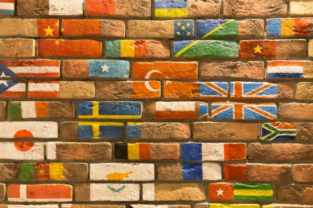brick wall covered with number of flags
