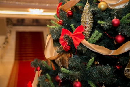 Christmas tree with staircase and red carpet on the background photo