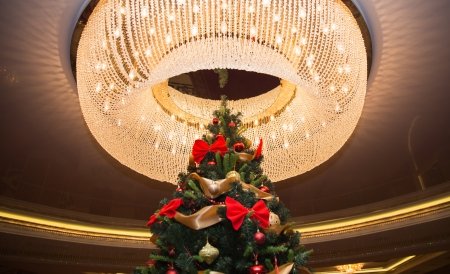 Tall christmas tree with round chandelier on a ceiling Stock Photo - 24726829